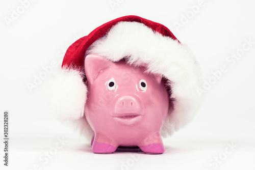 Little Christmas piggy bag with festive hat and white background.   #302328280