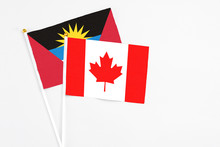 Canada And Antigua And Barbuda Stick Flags On White Background. High Quality Fabric, Miniature National Flag. Peaceful Global Concept.White Floor For Copy Space.