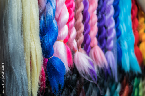 Canvastavla  Close-up view of the colorful artificial braiding hairs