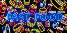Food And Drink Neon Sign. Fast Junk Food Vector Set. Big Burger, Hot Taco, Hot Pizza, Hot Dog. Neon Sign, Bright Signboard, Light Banner. Shine Panel