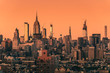 canvas print picture - Sunset above Manhattan skyscrapers, New York City. Light effect applied