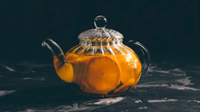 Glass Teapot With Tea From Ora...
