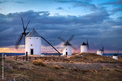 Foto auf Leinwand Schokobraun Windmills of Consuegra on sunset, Castilla-La Mancha, Spain