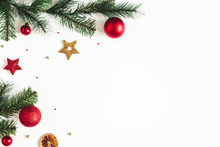 Christmas Composition. Fir Tree Branches, Red And Golden Decorations On White Background. Christmas, Winter, New Year Concept. Flat Lay, Top View, Copy Space