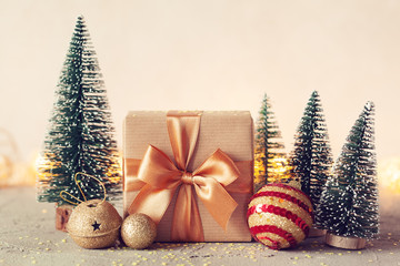 Christmas Composition with present box and christmas tree on neutral background. Holiday greeting card.