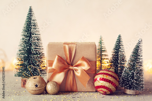 Fotografiet  Christmas Composition with present box and christmas tree on neutral background