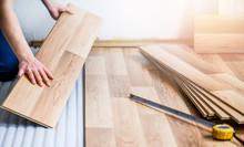 Worker Hands Installing Timber...
