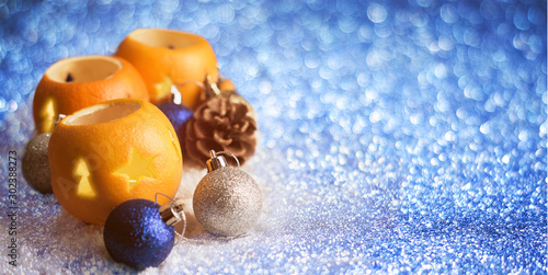 Christmas background with orange peel candlesticks and balls Wallpaper Mural
