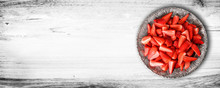 Strawberries Cut In Small Pieces At White Wooden Table Wide Banner Or Panorama. Fresh Red Strawberry Fruit On Silver Luxury Plate, Copy Space Concept.