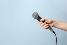 Female Hand With Microphone On...
