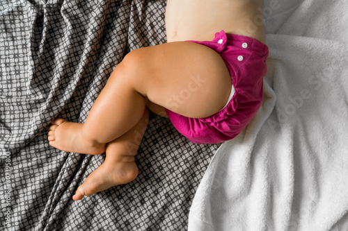 Fotografiet  Sleeping baby with cloth diaper