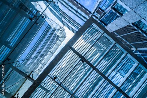 Obraz modern office building,blue toned image,china. - fototapety do salonu