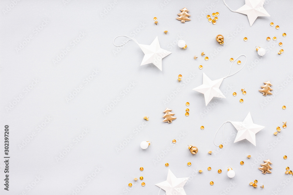 Fototapeta Gold and white christmas decoration on pastel blue background, flat lay, top view - obraz na płótnie