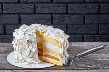 Sliced Coconut Cake On A Woode...