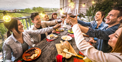 Young people having fun toasting red wine together at dinner party in outdoor vi Canvas Print