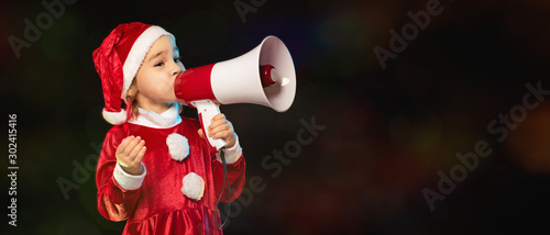Fotomural  Portrait of Little Adorable Girl in Costume Holding Megaphone for Announcement