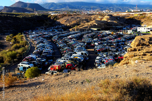 Deurstickers Oude verlaten gebouwen Scrap Yard With Pile Of Crushed Cars in tenerife canary islands spain