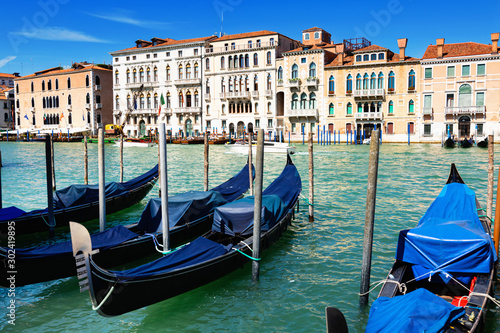 Ancient buildings and boats in the Grand canal in Venice. Italy