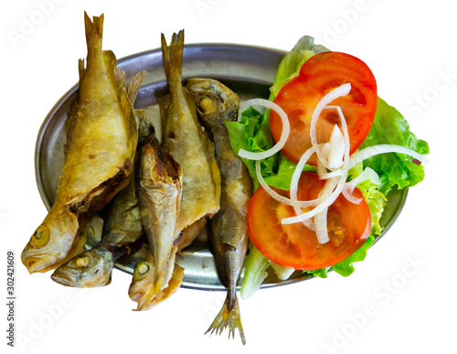 Tasty fried scad served  with tomatoes, onion and letucce Slika na platnu