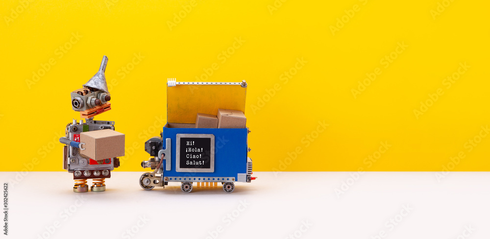 Fototapety, obrazy: Autonomous delivery robot concept. Local transportation robotic self-driving device with parcels delivered from store. Funny robot toy received a box from a courier. Yellow background copy space