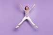 canvas print picture - Full length body size view of her she nice attractive lovely girlish cheerful cheery funky careless girl jumping having fun like star figure isolated on violet purple lilac pastel color background