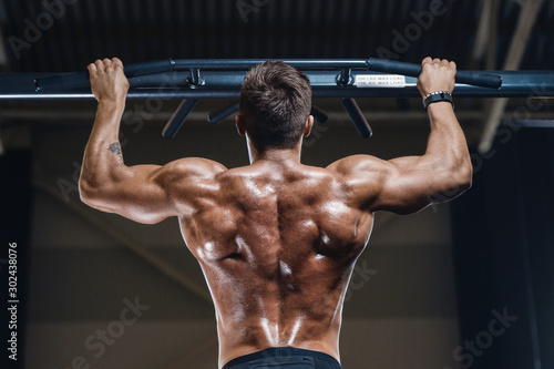 Handsome strong athletic men pumping up muscles workout fitness and bodybuild...