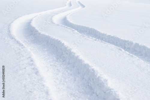 Photo Car tracks in the deep fresh snow