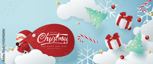Santa Claus with a huge bag on the run to delivery christmas gifts on white cloud background.Merry Christmas text Calligraphic Lettering Vector illustration.