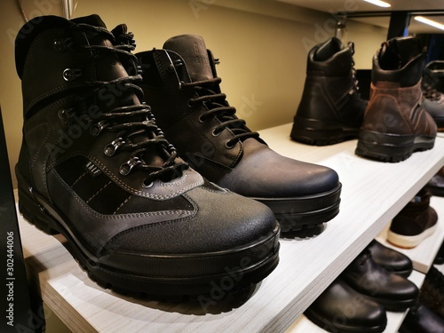 Obraz na plátně Ralph Ringer black and brown boots in an official store in St