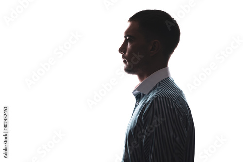 Obraz silhouette portrait of a man in profile in a business shirt isolate on white with a copy of the space - fototapety do salonu