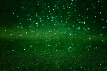 Green Abstract Glittering Background. Defocused Lights. Christmas Greeting Card. Christmas Or New Year Celebration Concept. Copy Space. Soft Focus