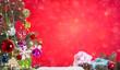 Leinwanddruck Bild Christmas tree, colorful ornament on red bokeh light background