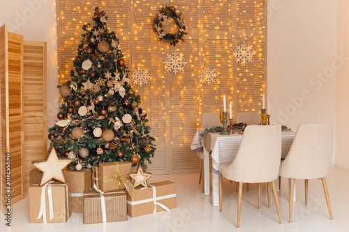 Christmas interior with big gold christmas tree and served table Canvas Print