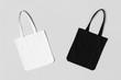Leinwanddruck Bild - White and black tote bags mockup on a grey background.