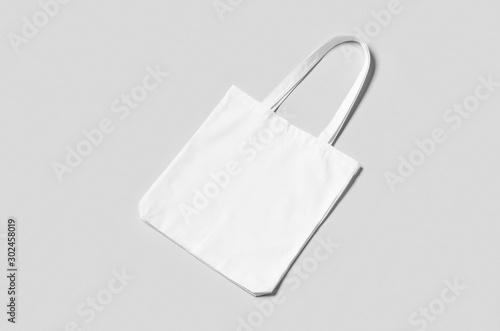 Obraz na plátně  White tote bag mockup on a grey background.