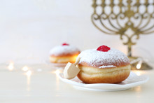Religion Image Of Jewish Holiday Hanukkah Background With Spinning Top And Doughnut Over White Background