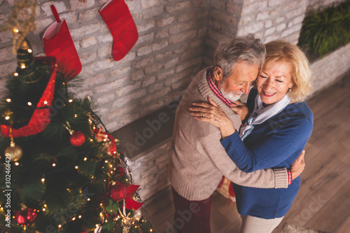Senior couple dancing waltz on Christmas Eve