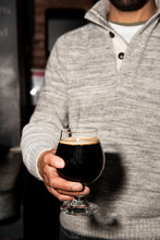Man Holding A Stout Beer In A Glass