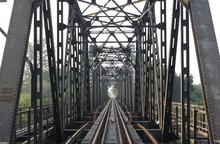 Railroad Tracks,old Railway Bridge Vintage,railway Bridge On River At Lampang Thailand.