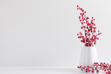 Winter Composition Of White Branches, Red Berries And Leaves With Sparkles In Vase On White Background. Christmas, New Year, Winter Concept. Front View, Copy Space