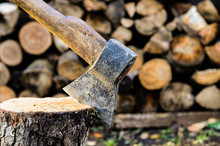 Axe On The Background Of Wooden Logs, Heating Season