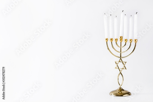 Fotografie, Obraz Jewish Hanukkah menorah isolated on white background. Copy space