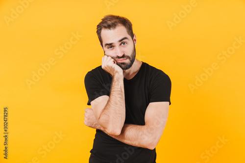 Fotografija Image of caucasian man in t-shirt propping up his head in boredom