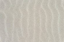 White Beach Sand Wavy Surface Background.