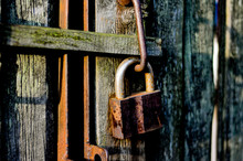 Rusty Lock On Wooden Background