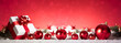 canvas print picture - Panoramic image of gift box and red christmas balls on snow