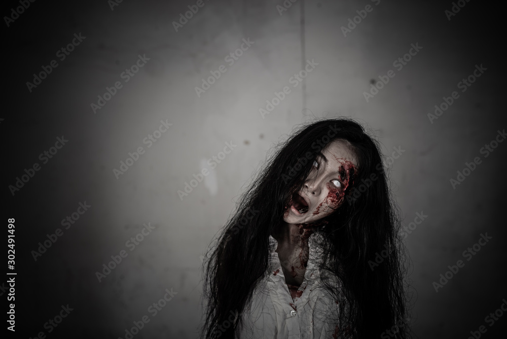 Fototapeta Portrait of asian woman make up ghost face,Horror scene,Scary background,Halloween poster