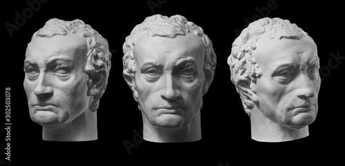 Three gypsum copy of ancient statue Gattamelata, Erasmo di Narni, head isolated on black background Canvas Print