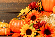 Fall Decoration Of Sunflowers, Mum Flowers Pumpkins And Gourds Arranged On Bale Of Hay, Thanksgiving Still Life With Rustic Wooden Background, Fall Background