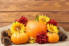 Pumpkins With Fall Flowers Arr...